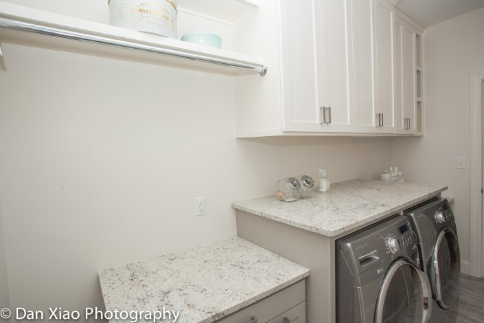 laundry room layout with lots of storage
