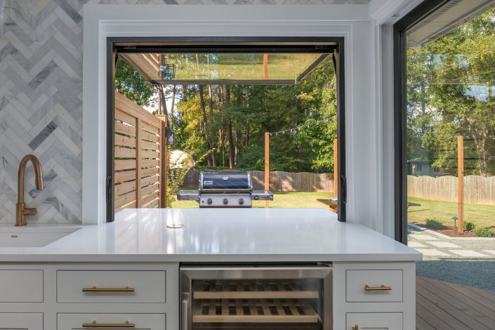 Tilt out window with fully extended counter top to connect the kitchen with the outside entertaining space.